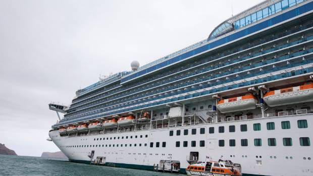Cruise ship Emerald Princess parked in Akaroa Harbour with around 3000 passengers.