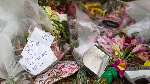 Tributes placed at the site where three teenagers died in a car crash near Leeston.