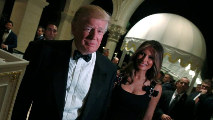 c60ce80331 US President-elect Donald Trump and his wife Melania Trump arrive for a New  Year's