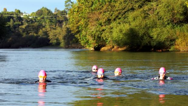 People regularly swim in the Waikato River.