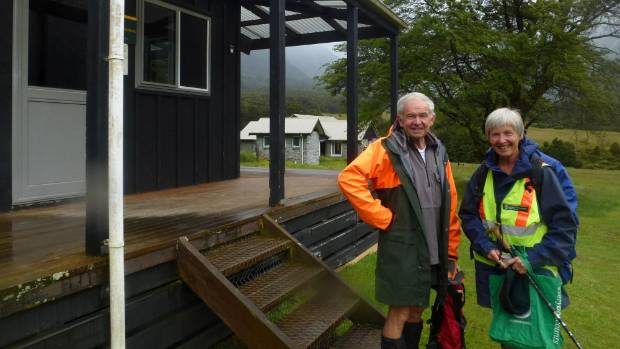 Stu and Heather Thorne outside the warden's hut at Aspiring Flat.