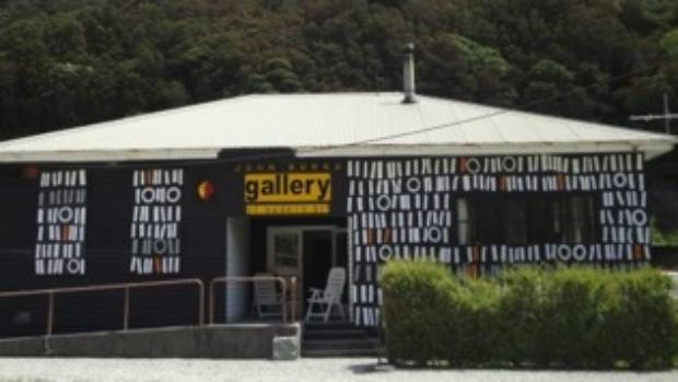 John Burns' art gallery is one of a handful properties not owned by Lester Rowntree.