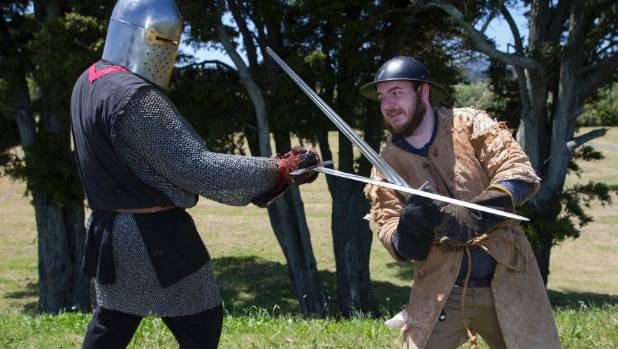 Reporter Paul Mitchell crosses swords with a member of the Red Ravens medieval re-enactment group.
