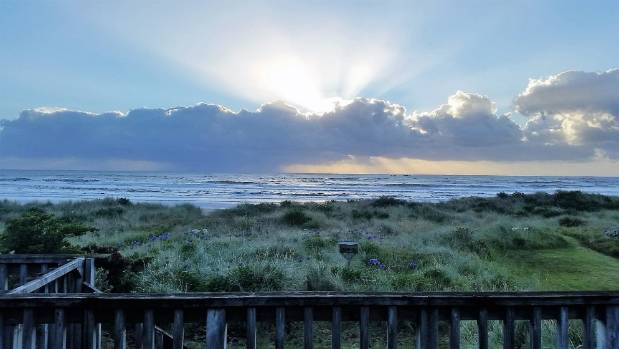 Sun rays burst through early morning cloud off Riversdale Beach in this photo taken by Jamie Cameron of Lower Hutt on ...