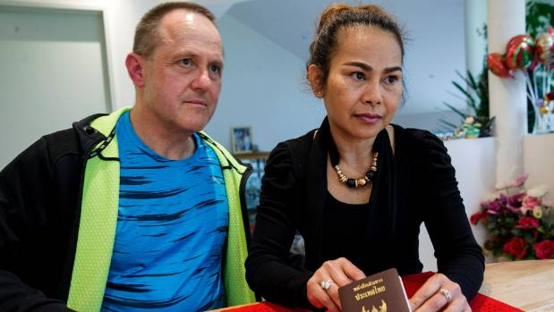 Gina Chompinitkul with her husband Volker Schroeter and her passport.