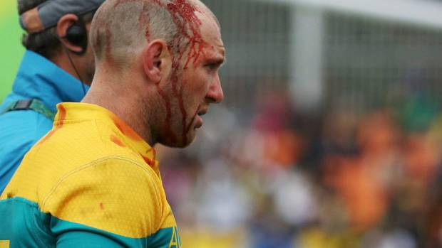 Rugby player James Stannard (AUS) of Australia leaves after sustaining a head injury during the Rio Olympics.