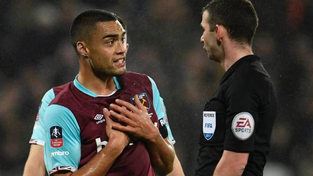 Winston Reid professes his innocence to the referee during the FA Cup encounter with Manchester City.