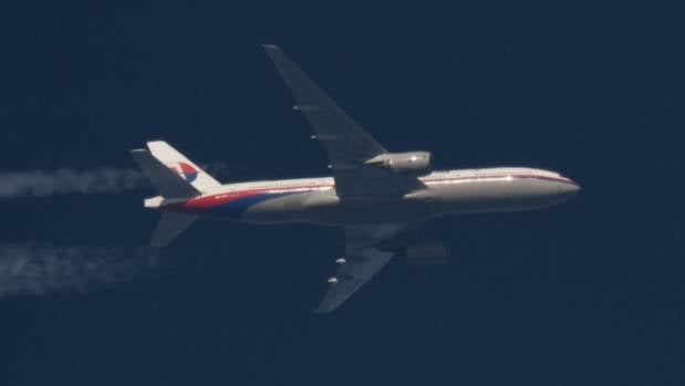 Malaysia Airlines Boeing 777 plane with registration number 9M-MRO flies over Poland in this February 5, 2014 file photo.