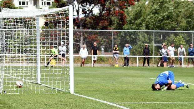 Team Wellington's goalkeeper Scott Basalaj fails to keep out a goal  against Auckland City on Sunday.