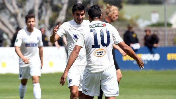 Auckland City's Emiliano Tade celebrates his goal against Team Wellington with Ryan de Vries (10) on Sunday. d
