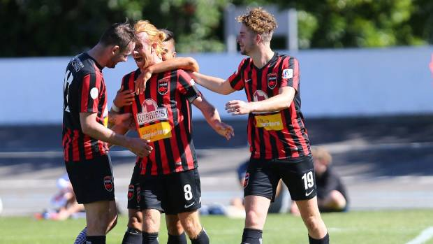 Canterbury captain Aaron Clapham is mobbed by team-mates after scoring against Tasman on Sunday.