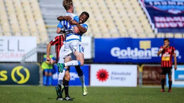 Tasman United players Dylan Burns and Tinashe Marowa celebrate after scoring in the team's 3-2 defeat to Canterbury at ...