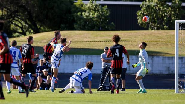 Canterbury United striker Stephen Hoyle scores the game-winning goal.