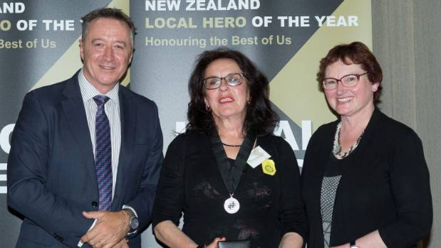 Wellington bus driver Cathy Howell, centre, won a 2016 Kiwibank Local Hero award.