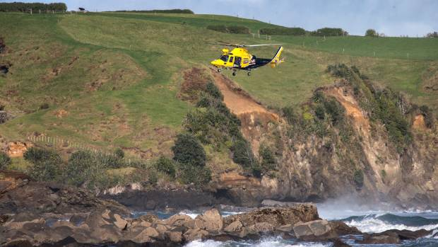 The chopper in action searching for a missing 18-year-old after a fishing boat he was in over turned near Back Beach in ...