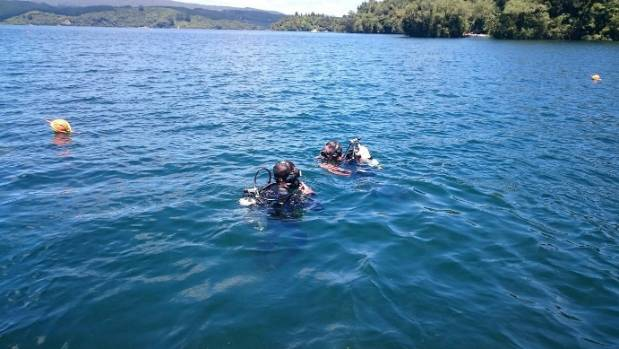 Police divers search the waters of Lake Rotoiti for the body of missing man Colin McCormick.