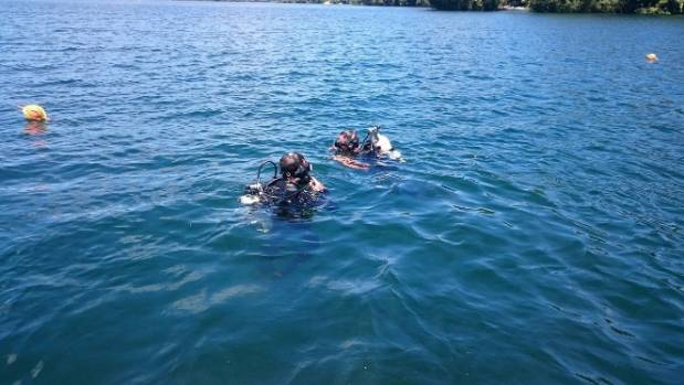 Police divers search the waters of Lake Rotoiti.
