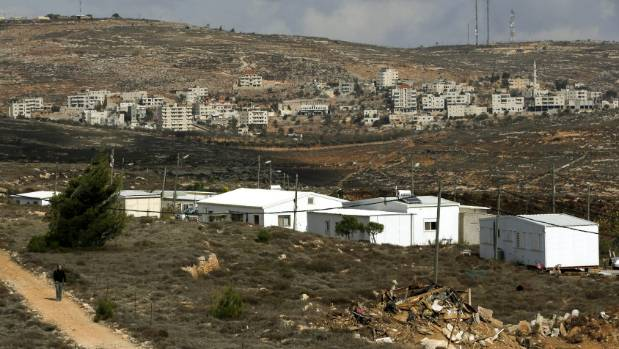A general view shows the Jewish settlers' outpost of Amona, front, and the Palestinian village of Silwad in the ...