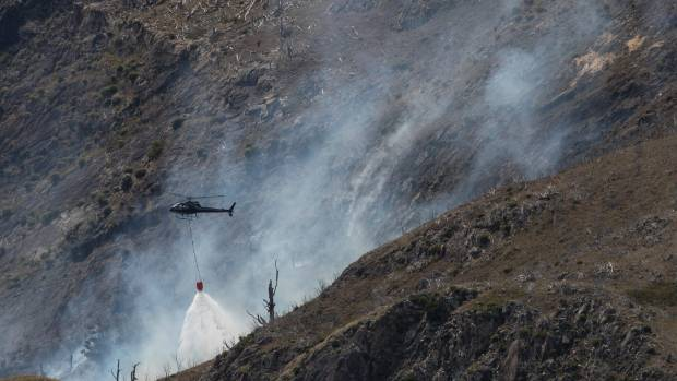 Five helicopters will battle a large fire until nightfall, with ground crews moving in early on Tuesday morning.