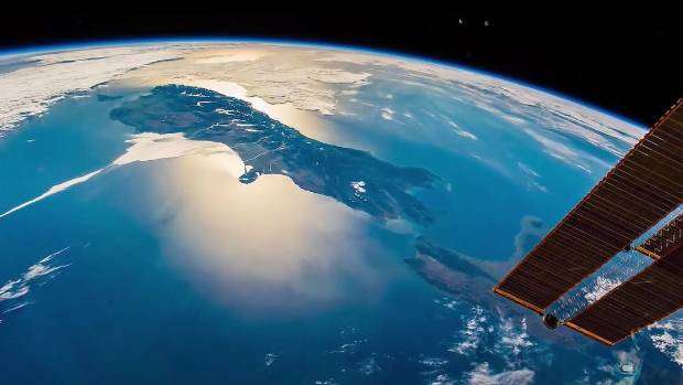 You can't see any space junk in this photo of New Zealand from space. But that doesn't mean it's not there (file pic).
