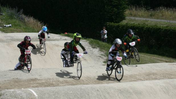 North Canterbury riders Ben Polden and Soul Atkinson seek to overtake Christchurch's Sebastian Stettner.