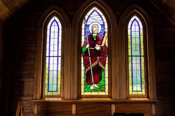 The stained glass window portrays St Thomas, the patron saint of construction.