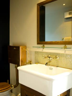 Traditional bathroom fixtures are in keeping with the era.