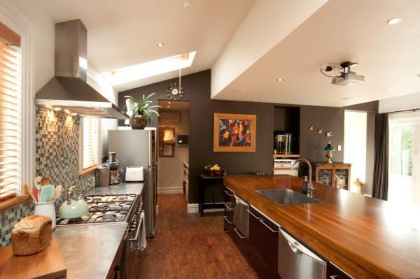 Beautiful rimu benchtops are a feature of the kitchen.