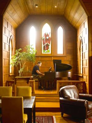 Lawton plays the grand piano within the nave.