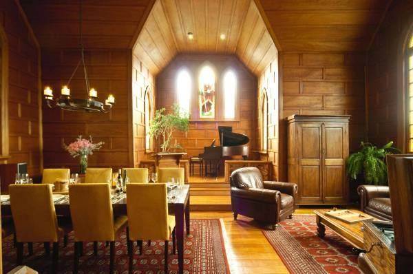 The restoration restored the original kauri wood panelling and floor.