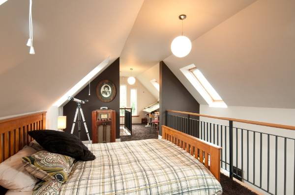 The master suite on the mezzanine floor is also flooded with natural light.