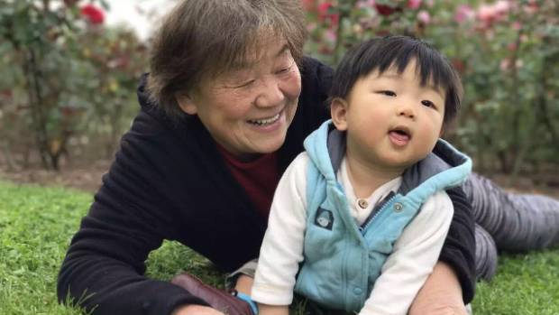 'Ray Ray' Li Chau is cared for by his doting 'Nai Nai' (nanny) Juan Chen.