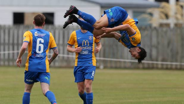Southern United's Eric Molloy, right, celebrates his goal with a back flip, watched by team mates Danny Ledwith, left, ...