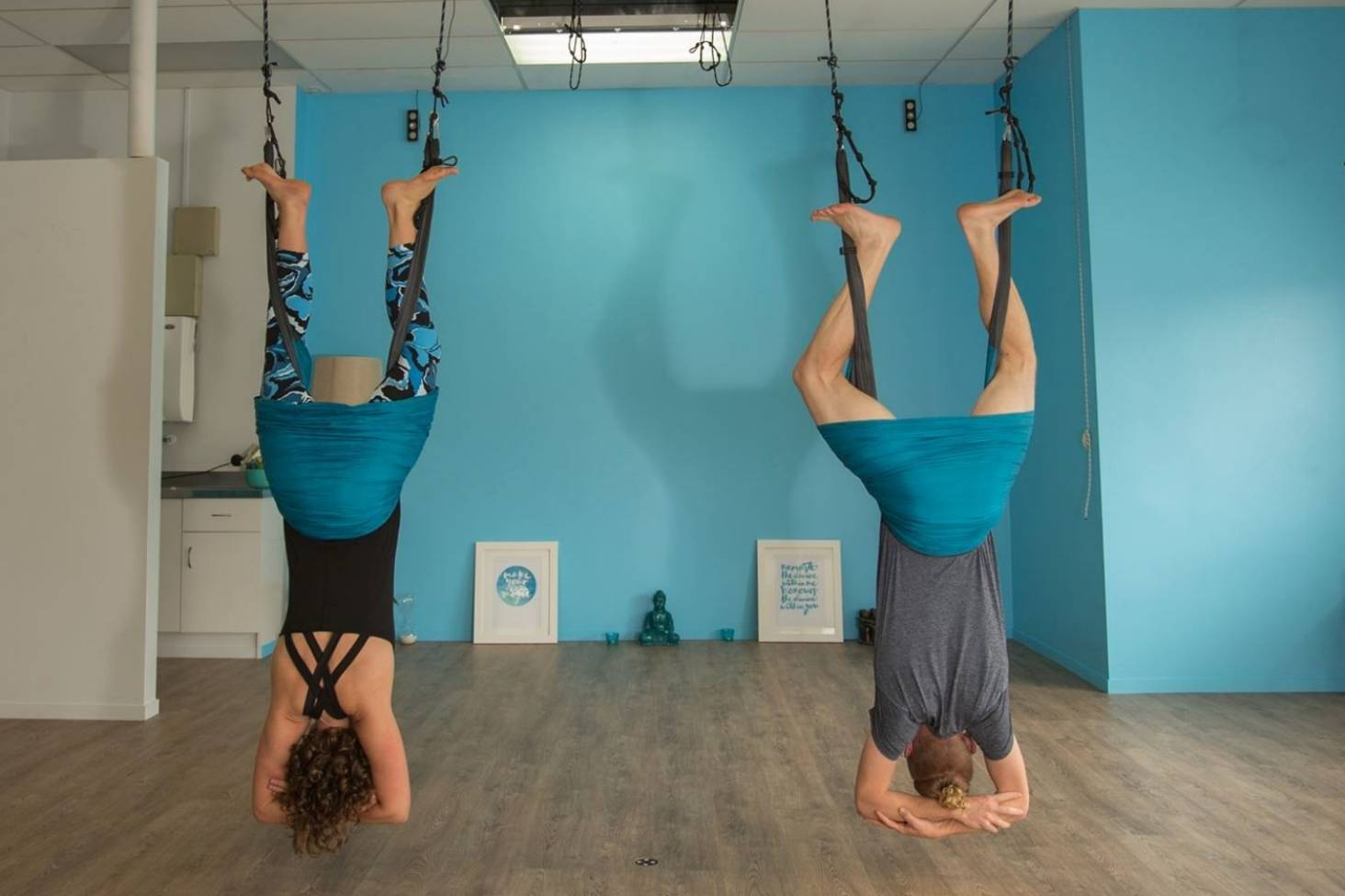 We try aerial yoga   pairing traditional poses with aerial arts ...