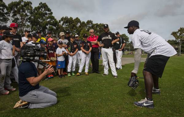 Didi Gregorius runs the juniors through a drill.