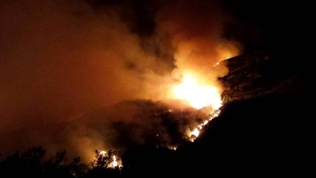 A large scrub fire is burning across about 50ha of land on Jessie Peak above Rat Point on the Glenorchy Road between ...