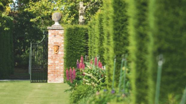 Brick pillars and macrocarpa hedges lend structure to the twin herbaceous borders which stretch for 110m.