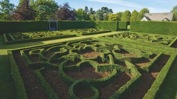 Trott's garden in Ashburton features a world-class knot garden. Alan Trott, who developed it, recently received a QSM ...