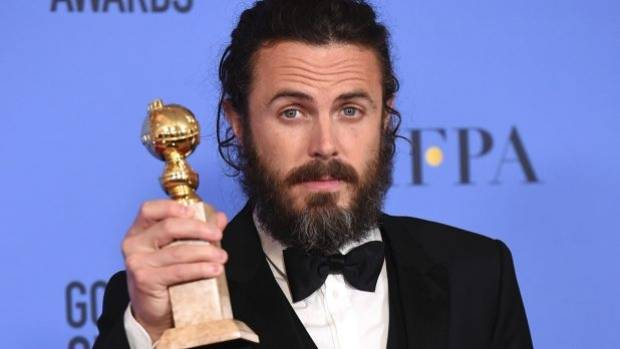 Casey Affleck poses with his Golden Globe for Manchester By The Sea. He was accused of sexual harassment of female ...