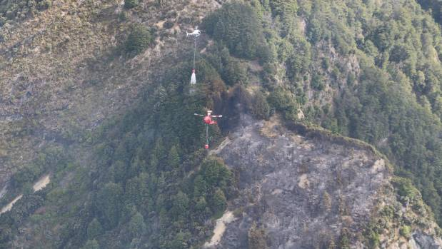 Helicopters tackle a fire on the Glenorchy Rd near Queenstown.