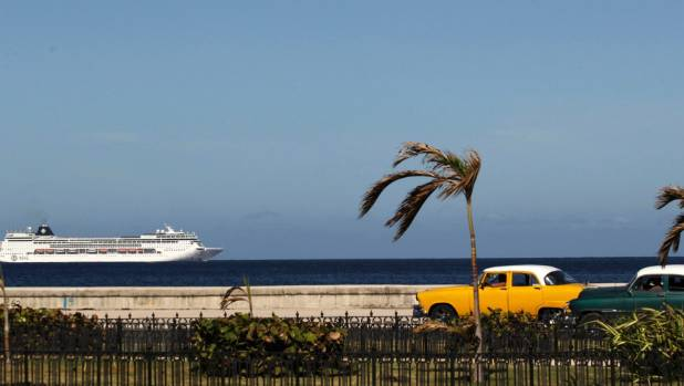 A cruise ship sails offshore in Havana, Cuba.