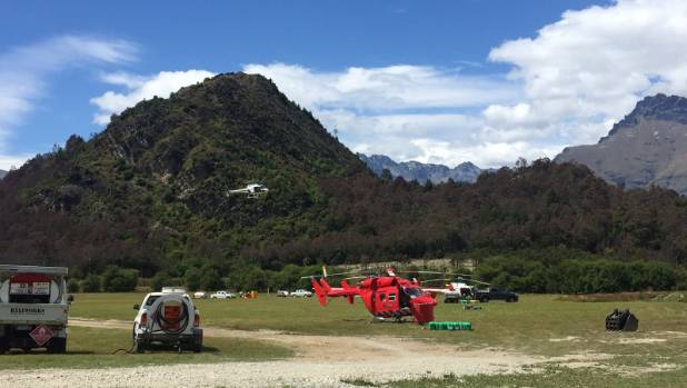 Helicopters, which are part of the firefighting effort for the scrub blaze near Glenorchy, at Bob's Cove about 12.30pm ...