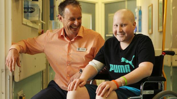 Matthew Mark, pictured with cancer patient Harry Foster, is stepping down from CEO of Ronald McDonald House South Island ...