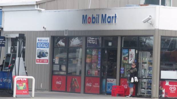 Police investigate the smash and grab of Mobil Mart on Dunedin's Anzac Avenue.