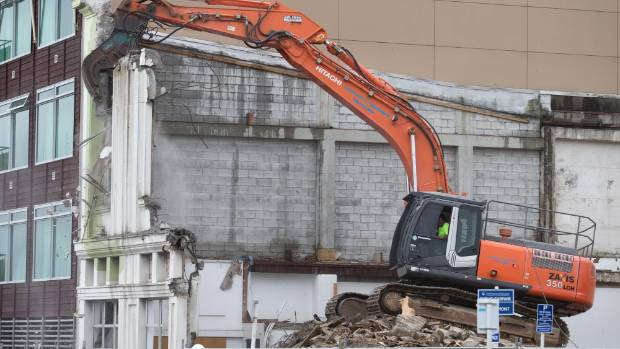 The Masters building on Egmont St in central New Plymouth is knocked to the ground.