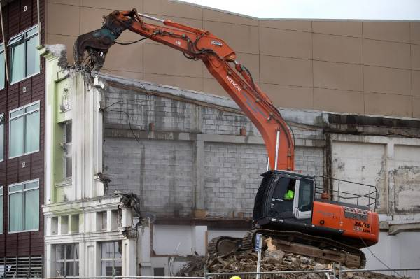 The demolition vehicle looked as though it was eating the building piece by piece.