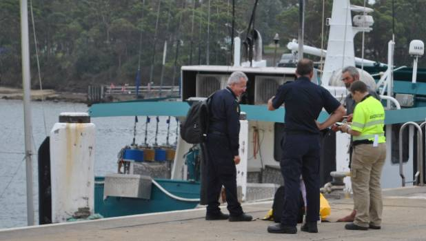 Alan Langdon speaks with Border Force officials at Ulladulla Harbour.