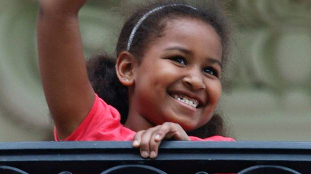 Sasha Obama waves from the Truman Balcony of the White House in Washington DC, May 14, 2009.