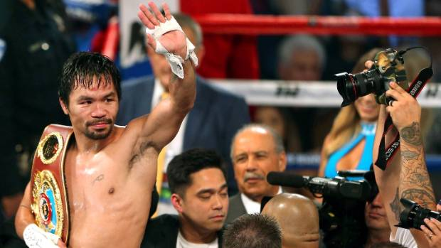 Manny Pacquiao of the Philippines celebrates after defeating Jessie Vargas of Las Vegas to become WBO welterweight champion.