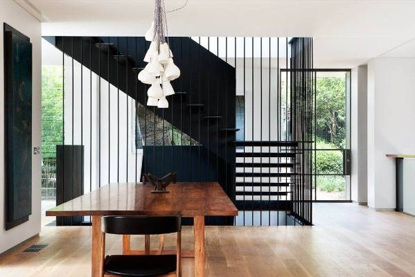 Black accents make a dramatic contrast to the white walls and American oak flooring.